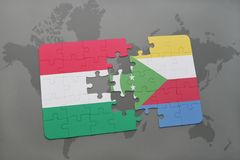 Puzzle with the national flag of hungary and comoros on a world map Stock Photos