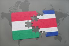 Puzzle with the national flag of hungary costa rica and on a world map Stock Photo
