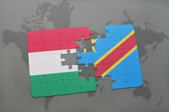 Puzzle with the national flag of hungary and democratic republic of the congo on a world map Royalty Free Stock Photos