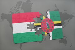 Puzzle with the national flag of hungary and dominica on a world map Stock Photo