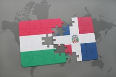 Puzzle with the national flag of hungary and dominican republic on a world map Royalty Free Stock Images