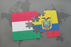 Puzzle with the national flag of hungary and ecuador on a world map Stock Photos