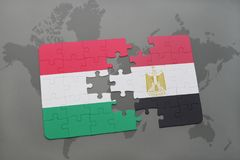 Puzzle with the national flag of hungary and egypt on a world map. Background. 3D illustration royalty free stock images