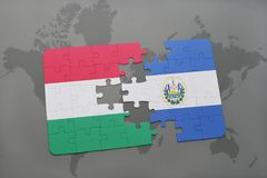 Puzzle with the national flag of hungary and el salvador on a world map Royalty Free Stock Image