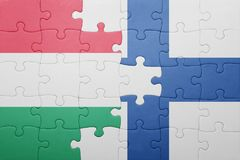 Puzzle with the national flag of hungary and finland. Concept Stock Photos