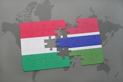 Puzzle with the national flag of hungary and gambia on a world map Royalty Free Stock Image