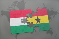Puzzle with the national flag of hungary and ghana on a world map Royalty Free Stock Images