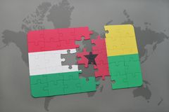 Puzzle with the national flag of hungary and guinea bissau on a world map Royalty Free Stock Photography