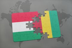 Puzzle with the national flag of hungary and guinea on a world map Royalty Free Stock Photo