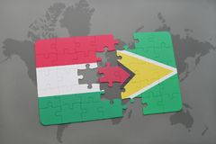 Puzzle with the national flag of hungary and guyana on a world map Royalty Free Stock Image