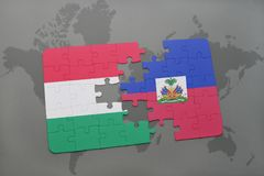 Puzzle with the national flag of hungary and haiti on a world map Stock Image