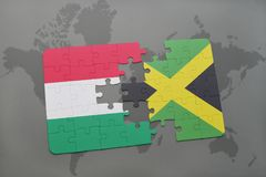 Puzzle with the national flag of hungary and jamaica on a world map Royalty Free Stock Photography