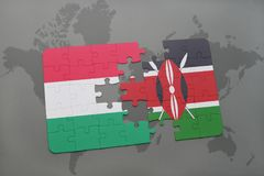 Puzzle with the national flag of hungary and kenya on a world map Royalty Free Stock Photography