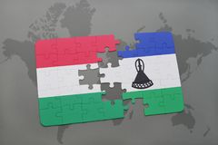 Puzzle with the national flag of hungary and lesotho on a world map Royalty Free Stock Images