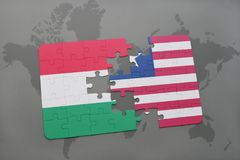 Puzzle with the national flag of hungary and liberia on a world map Royalty Free Stock Photos