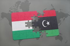 Puzzle with the national flag of hungary and libya on a world map Stock Photography