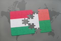 Puzzle with the national flag of hungary and madagascar on a world map Stock Photo