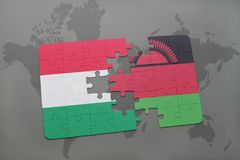 Puzzle with the national flag of hungary and malawi on a world map Stock Images
