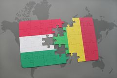 Puzzle with the national flag of hungary and mali on a world map Stock Images