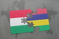 Puzzle with the national flag of hungary and mauritius on a world map Stock Photos