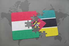 Puzzle with the national flag of hungary and mozambique on a world map. Background. 3D illustration Royalty Free Stock Image