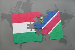 Puzzle with the national flag of hungary and namibia on a world map Royalty Free Stock Images