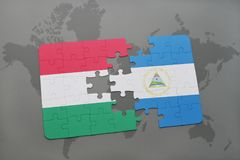 Puzzle with the national flag of hungary and nicaragua on a world map Stock Photos