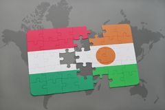 Puzzle with the national flag of hungary and niger on a world map Stock Image