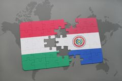 Puzzle with the national flag of hungary and paraguay on a world map Royalty Free Stock Image