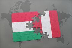 Puzzle with the national flag of hungary and peru on a world map Stock Photography