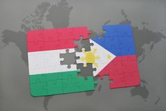 puzzle with the national flag of hungary and philippines on a world map Stock Photo