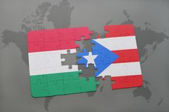 Puzzle with the national flag of hungary and puerto rico on a world map Stock Photography