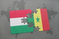 Puzzle with the national flag of hungary and senegal on a world map Stock Photos