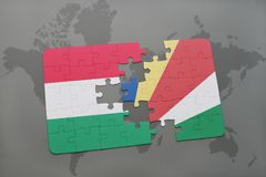 Puzzle with the national flag of hungary and seychelles on a world map Royalty Free Stock Images