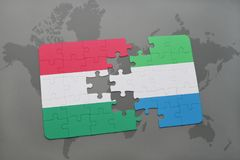 Puzzle with the national flag of hungary and sierra leone on a world map Royalty Free Stock Image