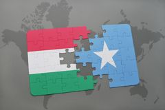 Puzzle with the national flag of hungary and somalia on a world map Stock Photos