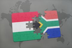 Puzzle with the national flag of hungary and south africa on a world map Stock Image