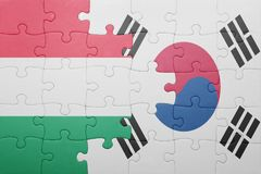 Puzzle with the national flag of hungary and south korea. Concept royalty free stock images