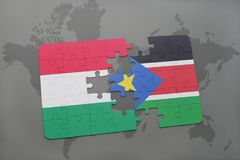 Puzzle with the national flag of hungary and south sudan on a world map Stock Photography