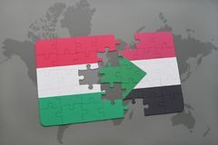Puzzle with the national flag of hungary and sudan on a world map Stock Photography