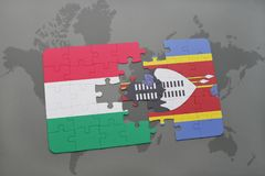 Puzzle with the national flag of hungary and swaziland on a world map Royalty Free Stock Photos
