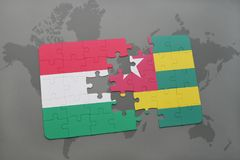 Puzzle with the national flag of hungary and togo on a world map Royalty Free Stock Photo