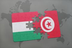 Puzzle with the national flag of hungary and tunisia on a world map Stock Image