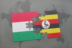 Puzzle with the national flag of hungary and uganda on a world map Royalty Free Stock Photography