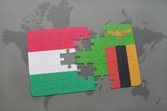 Puzzle with the national flag of hungary and zambia on a world map Stock Photos