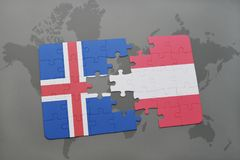 Puzzle with the national flag of iceland and austria on a world map background. 3D illustration Stock Image