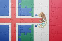 Puzzle with the national flag of iceland and mexico. Concept stock image