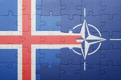 Puzzle with the national flag of iceland and nato Stock Photography