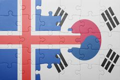 Puzzle with the national flag of iceland and south korea. Concept royalty free stock photo