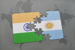 Puzzle with the national flag of india and argentina on a world map background. Royalty Free Stock Image